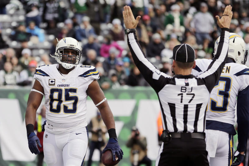 FILE - In this Dec. 24, 2017, file photo, Los Angeles Chargers tight end Antonio Gates (85) reacts after catching a pass for a touchdown during the first half of an NFL football game against the New York Jets, in East Rutherford, N.J. Gates announced his retirement, Tuesday, Jan. 14, 2020,  following a 16-year career that saw him finish with 116 touchdowns, which is the most by a tight end in NFL history. (AP Photo/Seth Wenig, File)