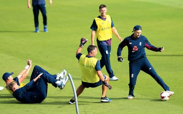England's cricketers will not be playing football in their warm-ups from now on (Simon Cooper/PA)