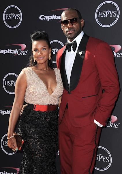 Miami Heat's LeBron James, right, and Savannah Brinson arrive at the ESPY Awards on Wednesday, July 17, 2013, at Nokia Theater in Los Angeles. (Photo by Jordan Strauss/Invision/AP)