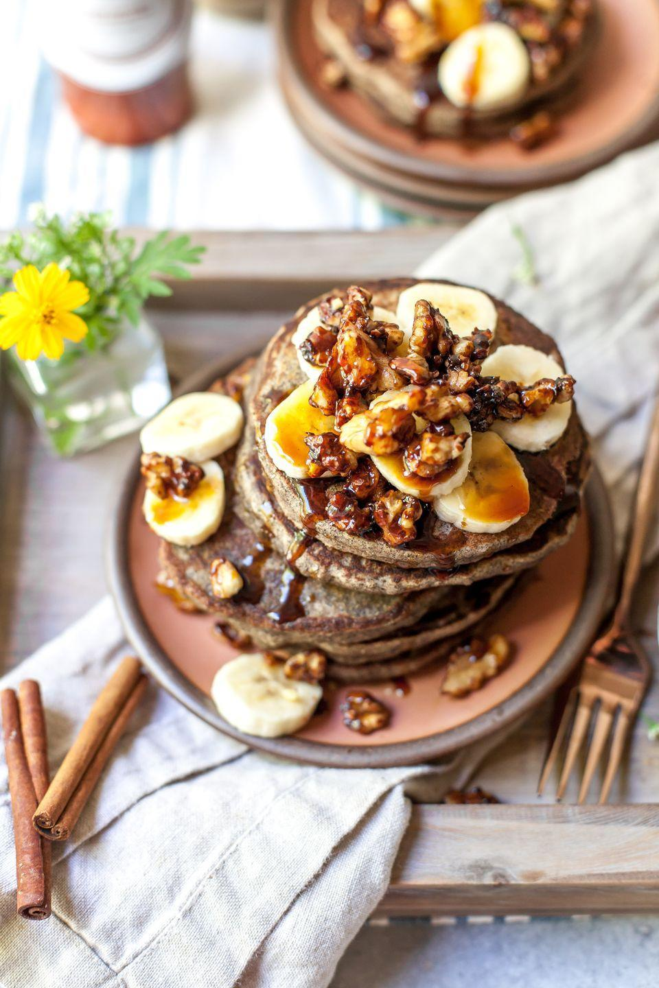 """<p>For a lighter take on pancakes, try swapping in buckwheat flour for a gluten-free breakfast that's also free of refined sugars. Yogurt and tahini help enhance the creamy profile of the banana in this pancake.</p><p><a href=""""https://dishingouthealth.com/buckwheat-banana-bread-pancakes/"""" rel=""""nofollow noopener"""" target=""""_blank"""" data-ylk=""""slk:Get the recipe from Dishing Out Health »"""" class=""""link rapid-noclick-resp""""><em>Get the recipe from Dishing Out Health »</em></a></p>"""