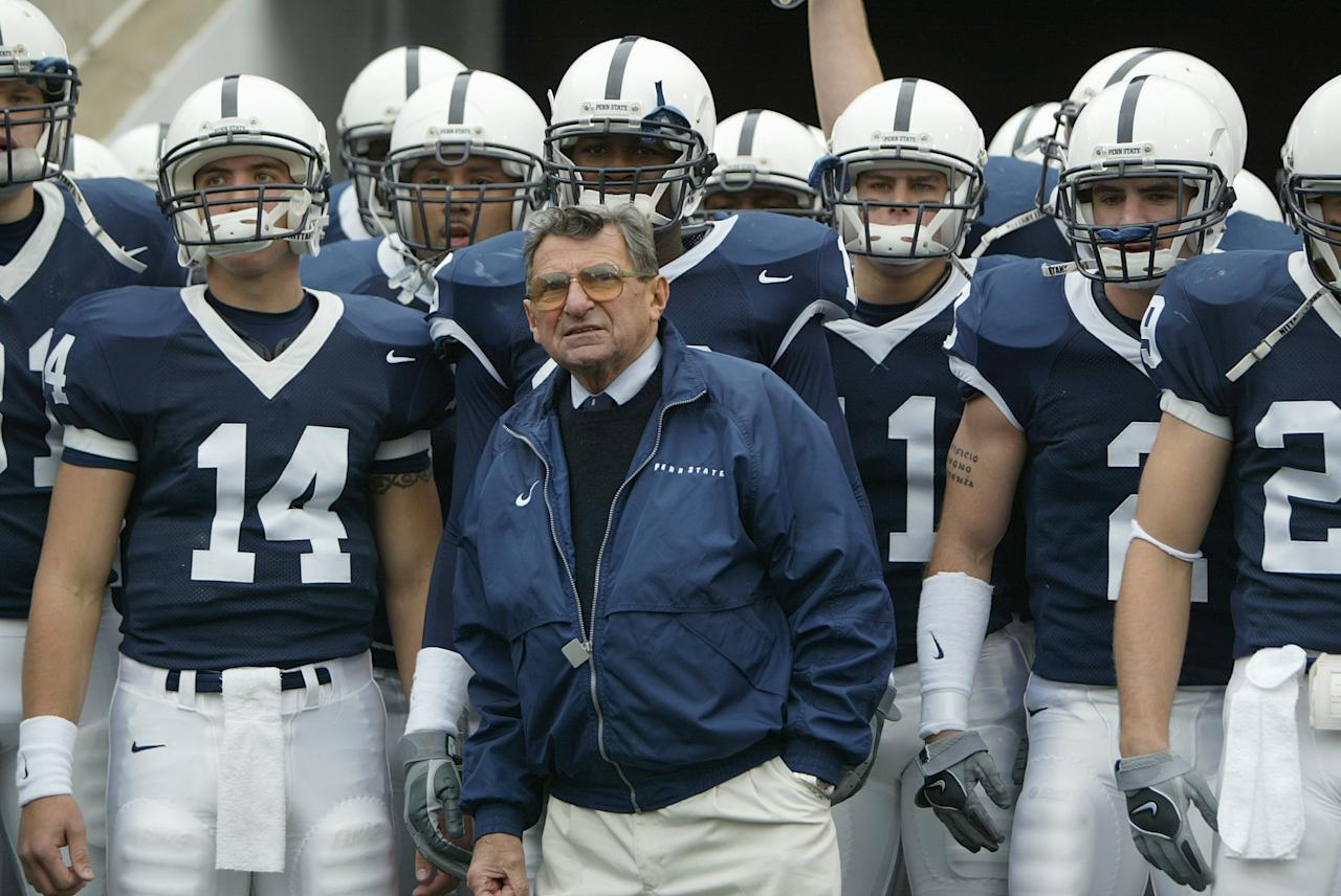 STATE COLLEGE, PA - FILE:  Head coach Joe Paterno and the Penn State Nittany Lions look on before facing the Iowa Hawkeyes at Beaver Stadium on October 23, 2004 in State College, Pennsylvania.  According to reports on November 9, 2011, Paterno will step down as head coach at the end of the season amid allegations that former assistant Jerry Sandusky was involved with child sex abuse. (Photo by Doug Pensinger/Getty Images)