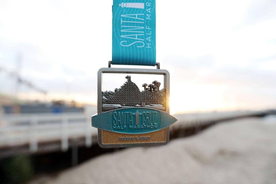 <p>We are proud of being runners, so it's only natural we frame a few race bibs to hang around the house. Add a medal rack and some finish photos to make the whole guest bedroom road-race themed.</p>