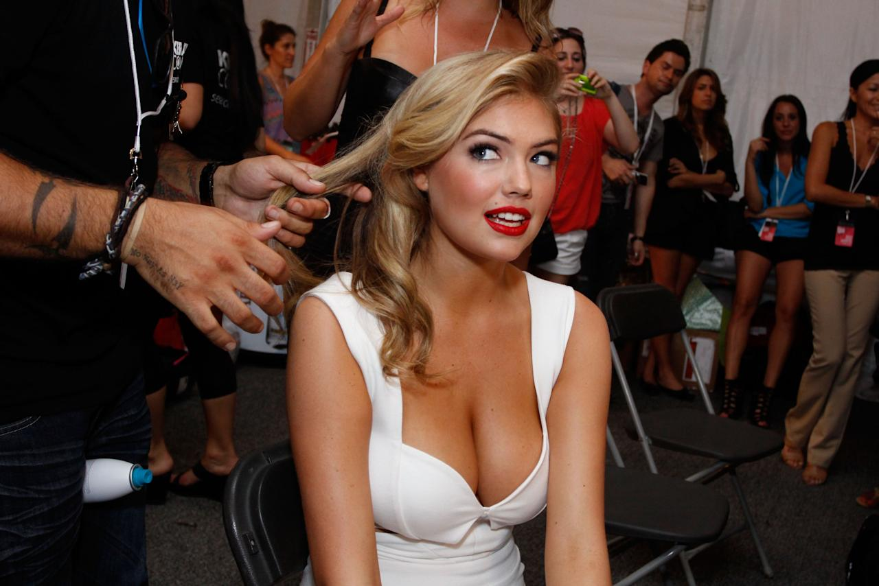 MIAMI BEACH, FL - JULY 15:  Kate Upton prepares backstage at the Beach Bunny Swimwear show during Mercedes-Benz Fashion Week Swim 2012 at The Raleigh on July 15, 2011 in Miami Beach, Florida.  (Photo by Donald Bowers/Getty Images for Make Up For Ever)