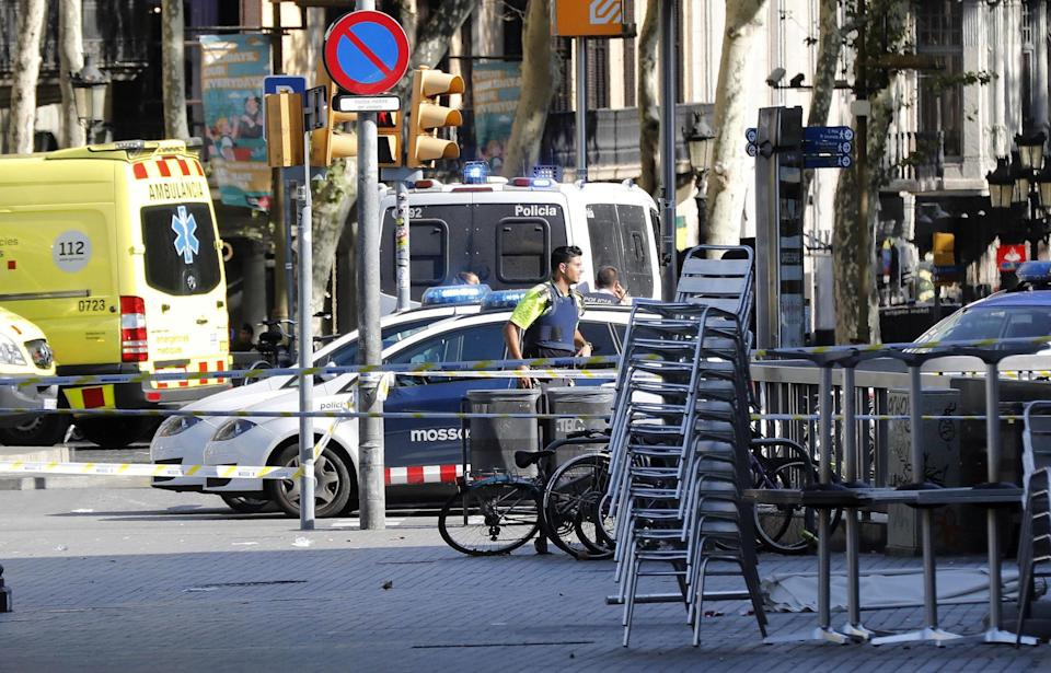 <p>Mossos d'Esquadra Police officers and emergency service workers set up a security perimeter near the site where a van crashes into pedestrians in Las Ramblas, downtown Barcelona, northeaster Spain, August 17, 2017. (Andreu Dalmau/EFE via ZUMA Press) </p>