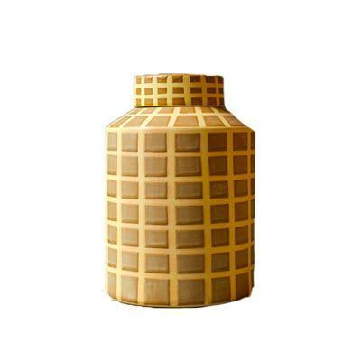 """<p><a class=""""link rapid-noclick-resp"""" href=""""https://www.pophamshome.com/shop/p/yellow-grid-stoneware-jar-by-broste"""" rel=""""nofollow noopener"""" target=""""_blank"""" data-ylk=""""slk:SHOP"""">SHOP</a></p><p>You can never have enough lovely jars for storing things in your kitchen, and this beautiful ceramic one made by Scandi homeware brand Broste comes in a pleasing yellow grid pattern. </p><p>£46, <a href=""""https://www.pophamshome.com/shop/p/yellow-grid-stoneware-jar-by-broste"""" rel=""""nofollow noopener"""" target=""""_blank"""" data-ylk=""""slk:Pophams"""" class=""""link rapid-noclick-resp"""">Pophams</a></p>"""