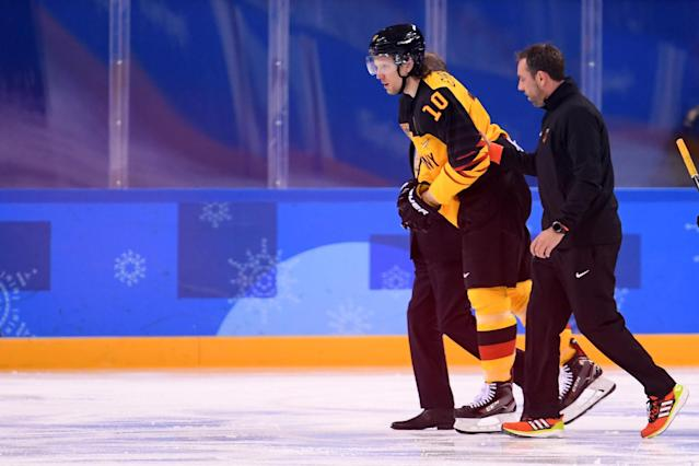 Christian Ehrhoff is helped off the ice during Germany's qualification game against Switzerland in PyeongChang, South Korea on Tuesday. (Getty)
