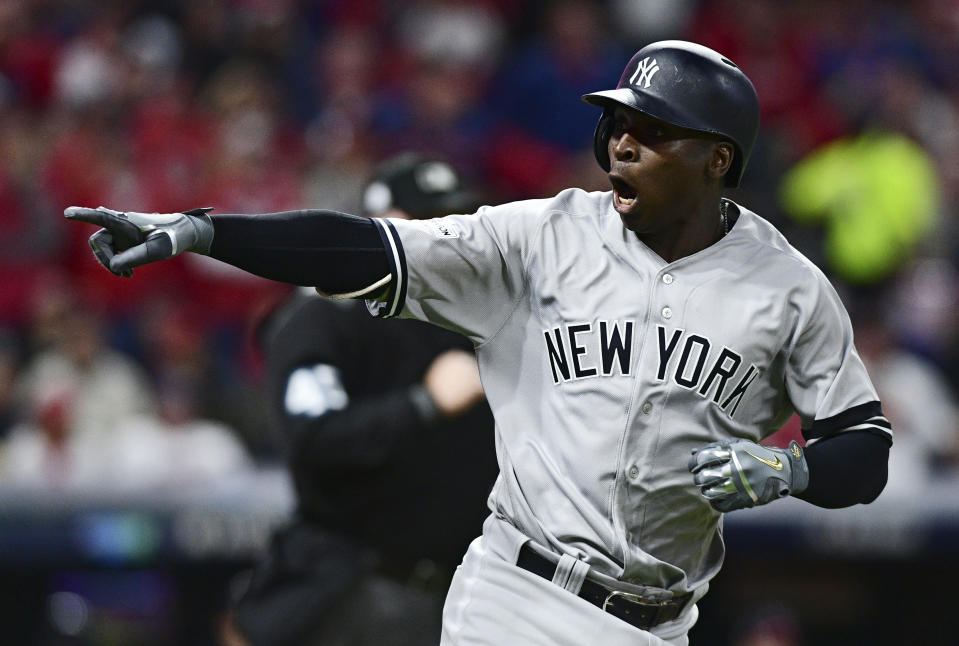 Yankees' Didi Gregorius points to the dugout after hitting his second home run of Game 5. (AP)