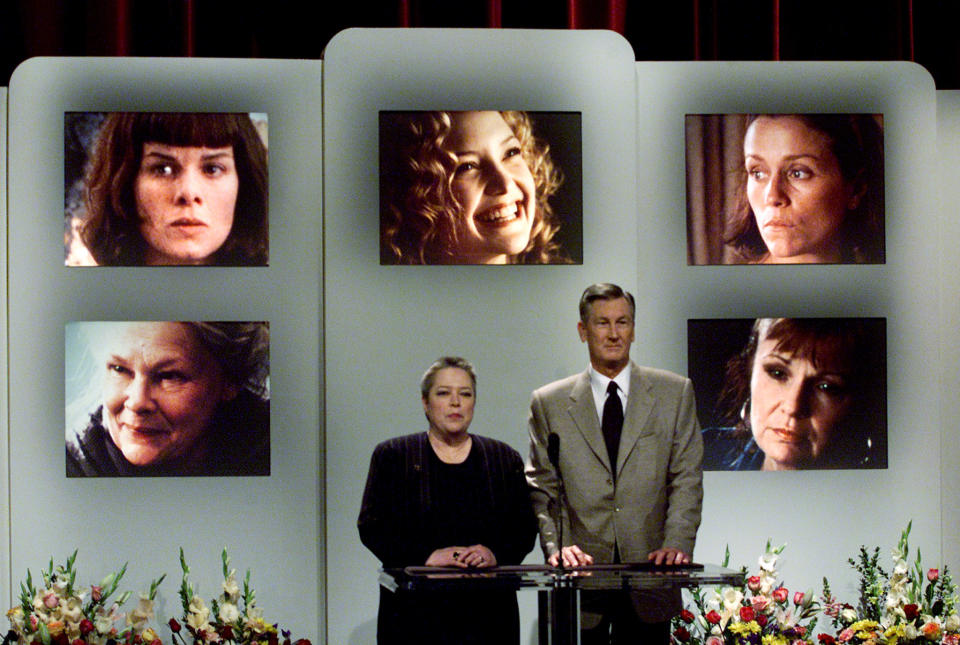 Academy of Motion Picture Arts and Sciences president Robert Rehme and Oscar winning actress Kathy Bates (L) announce the nominations for Best Supporting Actress for the 73rd annual Academy Awards during a live telecast February 13, 2001 from academy headquarters in Beverly Hills. Nominess for best supporting actress are, photographs (lower left to right) Judi Dench in