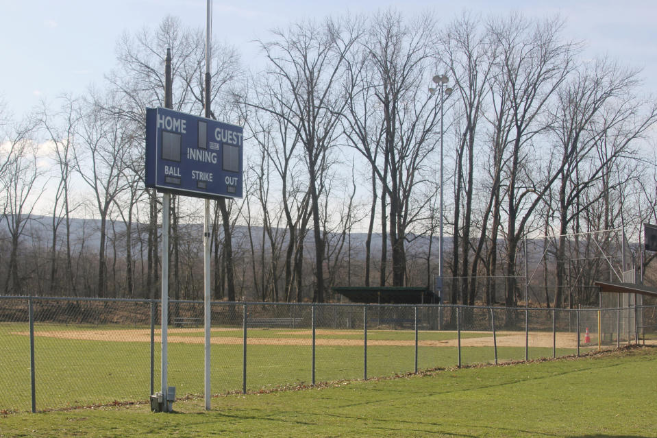An empty Little League baseball field is shown in Washingtonville, N.Y., Wednesday, April 1, 2020. Mike DeLuca envisioned his youngest son, John, capping his baseball career the same way most 12-year-old All-Star squads from Monroeville, Pennsylvania, had for the last two decades: with a week spent playing teams from all over the country at Cooperstown Dreams Park in early August. Then the COVID-19 pandemic arrived in the United States and the shutdowns began. (AP Photo/Paul Kazdan)