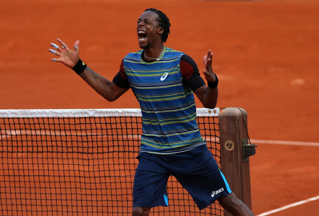 PARIS, FRANCE - MAY 27: Gael Monfils of France celebrates match point in his Men's Singles match against Tonas Berdych of Czech Republic during day two of the French Open at Roland Garros on May 27, 2013 in Paris, France. (Photo by Getty Images/Getty Images)