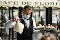 Customers returned to Paris cafe terraces Wednesday after six months of closures