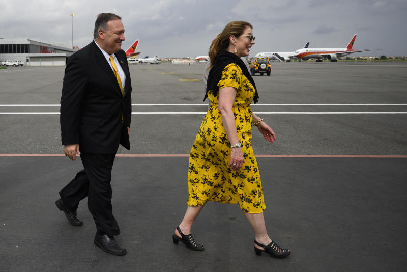 US Secretary of State, Mike Pompeo, right, and his wife, Susan Pompeo walk on the tarmac before leaving Angola at the Luanda International Airport in Luanda, Angola, Monday Feb. 17, 2020. Pompeo started his tour of Africa in Senegal, the first U.S. Cabinet official to visit in more than 18 months. He left Senegal Sunday to arrive in Angola and will then travel on to Ethiopia as the Trump administration tries to counter the growing interest of China, Russia and other global powers in Africa and its booming young population of more than 1.2 billion. (Andrew Caballero-Reynolds/Pool via AP)