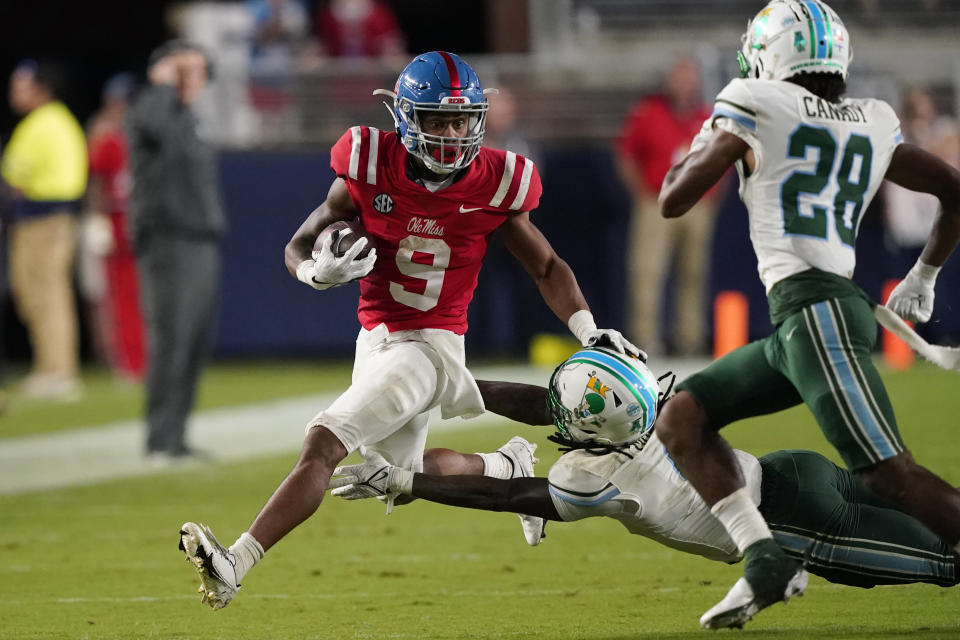 Mississippi running back Jerrion Ealy (9) evades a tackle attempt by Tulane cornerback Jaylon Monroe (9) during the first half of an NCAA college football game Saturday, Sept. 18, 2021, in Oxford, Miss. (AP Photo/Rogelio V. Solis)