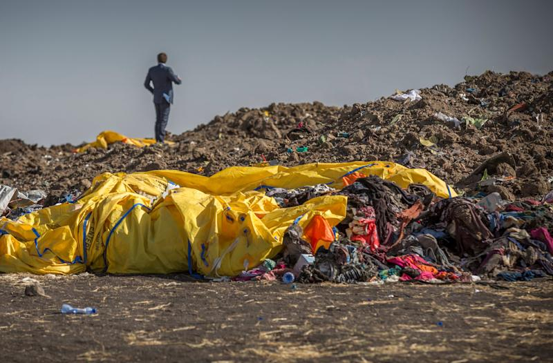 Wreckage lies at the scene where the Ethiopian Airlines Boeing 737 Max 8 crashed shortly after takeoff on Sunday killing all 157 on board, near Bishoftu, or Debre Zeit, south of Addis Ababa, in Ethiopia Tuesday, March 12, 2019. Ethiopian Airlines had issued no new updates on the crash as of late afternoon Tuesday as families around the world waited for answers, while a global team of investigators began picking through the rural crash site. (AP Photo/Mulugeta Ayene)