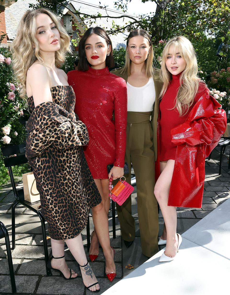 <p>Dove Cameron, Lucy Hale, Olivia Holt and Sabrina Carpenter attend the Michael Kors Spring/Summer 2022 show during New York Fashion Week at Tavern on the Green on Sept. 10.</p>
