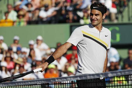 Mar 24, 2018; Key Biscayne, FL, USA; Roger Federer of Switzerland smiles after a point against Thanasi Kokkinakis of Australia (not pictured) on day five of the Miami Open at Tennis Center at Crandon Park. Kokkinakis won 3-6, 6-3, 7-6(4). Mandatory Credit: Geoff Burke-USA TODAY Sports