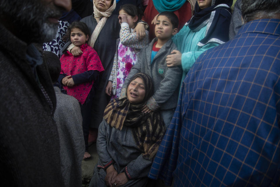 An unidentified relative cries during the funeral of elected official Riyaz Ahmad in Sopore, 55 kilometers (34 miles) north of Srinagar, Indian controlled Kashmir, Monday, March. 29, 2021. Gunmen killed an elected official of India's ruling party and a policeman in disputed Kashmir on Monday, police said. Police blamed anti-India militants for the attack. None of the rebel groups that have been fighting against Indian rule since 1989 immediately claimed responsibility for the attack. (AP Photo/Mukhtar Khan).