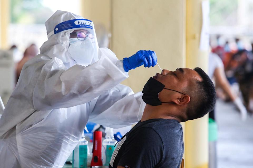 Health officers conduct the Covid-19 antigen rapid test at Laurent Bleu, CMC Centre Cheras January 11, 2021. — Picture by Choo Choy May