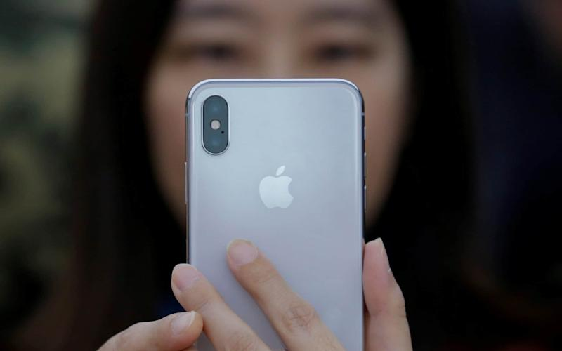 A researcher has found a way to crash iPhones with a single text - REUTERS