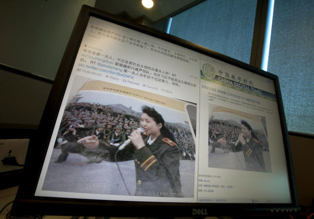 A computer screen shows websites displaying an undated photo of China's new first lady Peng Liyuan in younger days singing to martial law troops following the 1989 bloody military crackdown on pro-democracy protesters, in Beijing, China, Thursday, March 28, 2013. The photo appeared online this week but was swiftly scrubbed from China's Internet before it could generate discussion online. But the image - seen and shared by outside observers - revived a memory the leadership prefers to suppress and shows one of the challenges in presenting Peng on the world stage as the softer side of China. (AP Photo/Ng Han Guan)