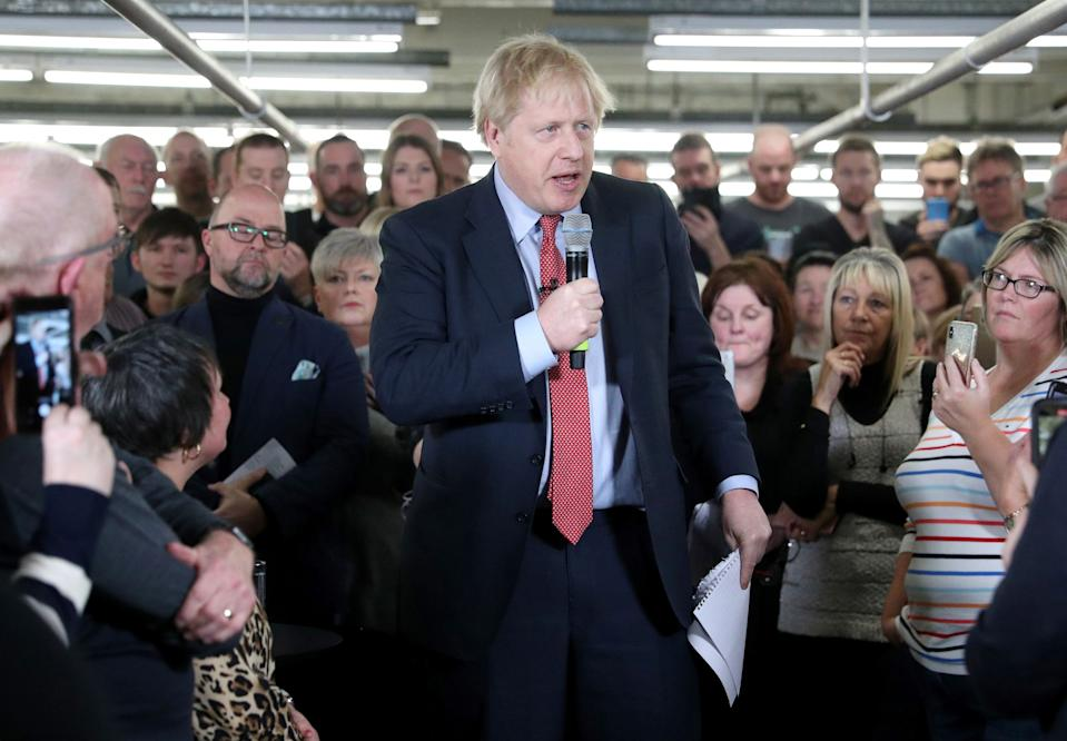 Britain's Prime Minister Boris Johnson speaks to workers during a Conservative Party general election campaign visit to John Smedley Mill in Matlock, central England, on December 5, 2019. - Britain will go to the polls on December 12, 2019 to vote in a pre-Christmas general election. (Photo by HANNAH MCKAY / POOL / AFP) (Photo by HANNAH MCKAY/POOL/AFP via Getty Images)