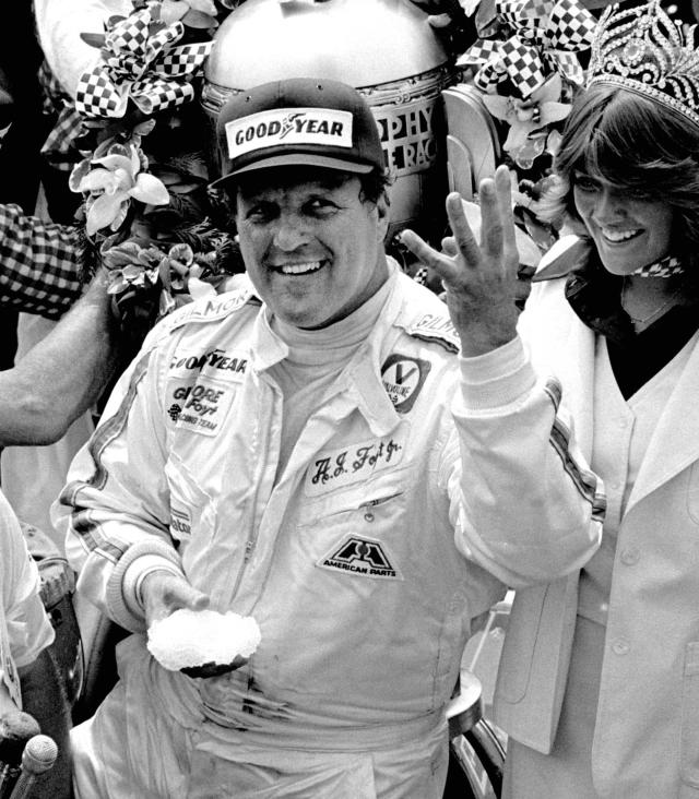 FILE - In this May 29, 1977, file photo, driver A.J. Foyt holds up four fingers in Victory Lane after winning his fourth Indianapolis 500 auto race at Indianapolis Motor Speedway in Indianapolis. Foyt won the Indy 500 auto race in 1961, 1964, 1967 and 1977. Hes been coming to Indianapolis every May since 1958 and every year, crowds gather around the first garage stall in Gasoline Alley waiting to have an old photograph signed by their racing hero or merely to catch a glimpse of the former racing star. (AP Photo/File)