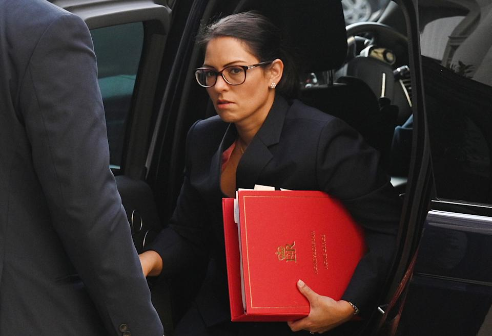 Britain's Home Secretary Priti Patel arrives at Foreign, Commonwealth and Development Office (FCDO) in central London on September 22, 2020 to attend the weekly meeting of the cabinet. - The UK government will on Tuesday announce new measures to curb rising coronavirus cases across England, hours after upgrading the virus alert level with top advisers warning of a surging death toll within two months without immediate action. (Photo by Leon Neal / POOL / AFP) (Photo by LEON NEAL/POOL/AFP via Getty Images)
