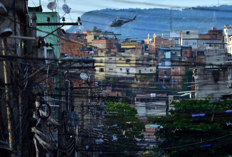 A police helicopter overflies the Favela da Mare shantytown complex in Rio de Janeiro in March 2014 -- the use of helicopters in police raids has increased in recent months (AFP Photo/CHRISTOPHE SIMON)