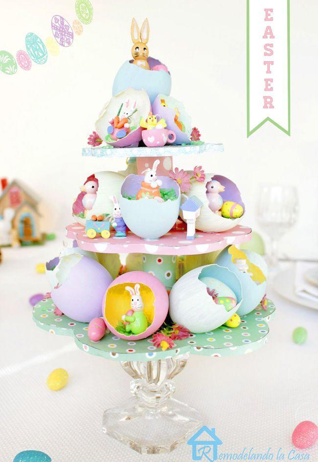 """<p>Dress up your <a href=""""https://www.countryliving.com/entertaining/g2256/easter-table-displays-0406/"""" rel=""""nofollow noopener"""" target=""""_blank"""" data-ylk=""""slk:Easter table"""" class=""""link rapid-noclick-resp"""">Easter table</a> with this fun take on the Easter tree! You can make your own tiered stand or buy one readymade. (Search """"cardboard cupcake stand"""" for best results.)</p><p><strong>Get the tutorial at <a href=""""https://www.remodelandolacasa.com/2014/03/easter-egg-tree-centerpiece.html"""" rel=""""nofollow noopener"""" target=""""_blank"""" data-ylk=""""slk:RemodelaCasa"""" class=""""link rapid-noclick-resp"""">RemodelaCasa</a>.</strong></p><p><a class=""""link rapid-noclick-resp"""" href=""""https://www.amazon.com/3-Tier-Cardboard-Cupcake-Stand-Tower/dp/B07GGVJGJ9/ref=sr_1_6?tag=syn-yahoo-20&ascsubtag=%5Bartid%7C10050.g.26498744%5Bsrc%7Cyahoo-us"""" rel=""""nofollow noopener"""" target=""""_blank"""" data-ylk=""""slk:SHOP CUPCAKE STANDS"""">SHOP CUPCAKE STANDS</a></p>"""
