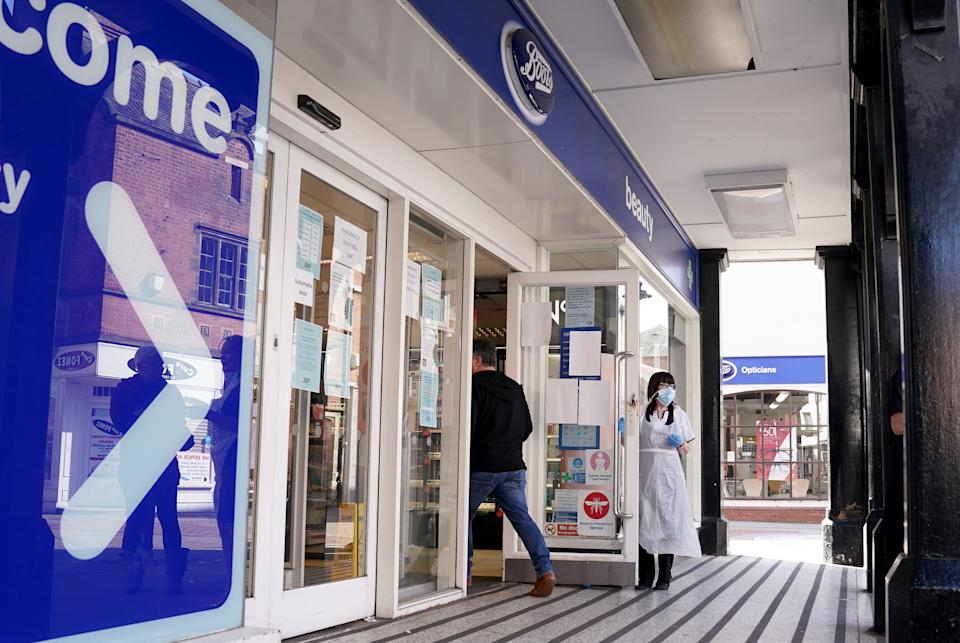 A general view of Boots operating a one in one out system for the pharmacy use only in Lichfield, the day after Prime Minister Boris Johnson called on people to stay at home and avoid all non-essential contacts and travel in order to reduce the impact of the coronavirus pandemic.