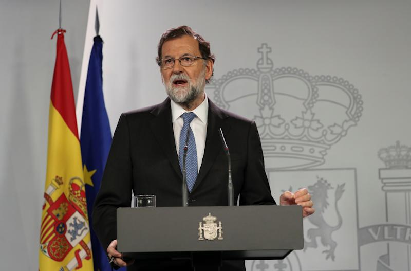 Spain's Prime Minister Mariano Rajoy delivers a statement after an extraordinary Cabinet meeting at the Moncloa Palace in Madrid on Friday. (Susana Vera / Reuters)