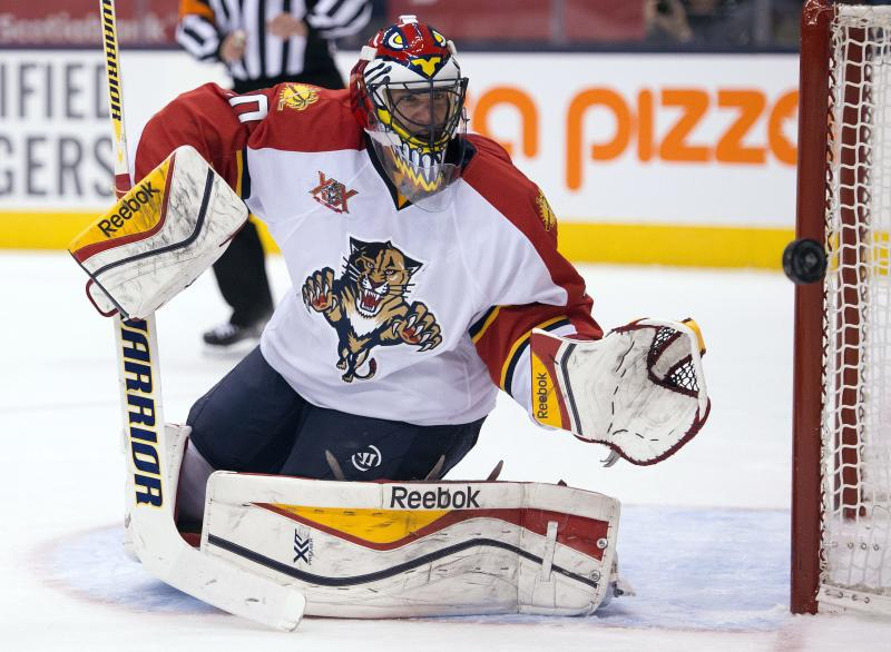 Florida Panthers goaltender Scott Clemmensen (30) makes a save on the Toronto Maple Leafs during third period NHL action in Toronto on Tuesday, Dec. 17, 2013. (AP Photo/The Canadian Press, Frank Gunn)