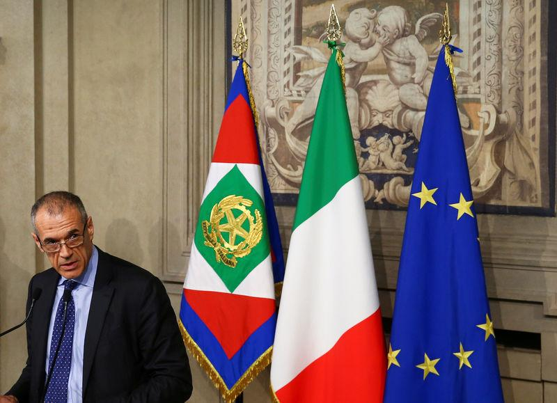 FILE PHOTO: Former senior International Monetary Fund (IMF) official Carlo Cottarelli speaks to the media after a meeting with Italy's President Sergio Mattarella at the Quirinal Palace in Rome