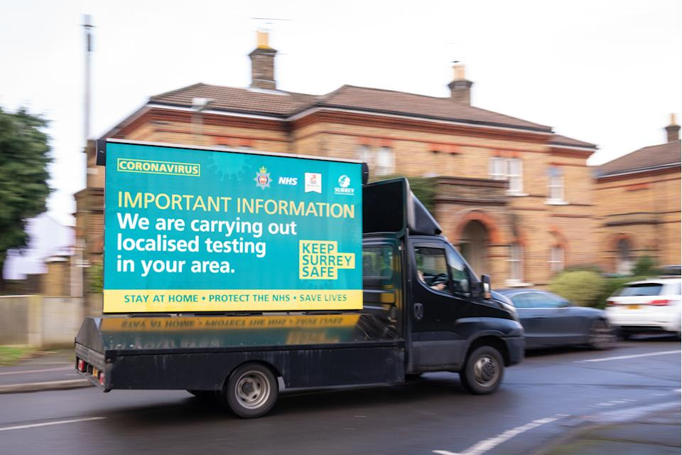 "A mobile billboard announces door-to-door coronavirus testing in Woking, Surrey, part of a testing blitz of 80,000 people in England which is aiming to find ""every single case"" of the South Africa coronavirus variant in a bid to stop the spread of the more infectious strain. Picture date: Tuesday February 2, 2021."