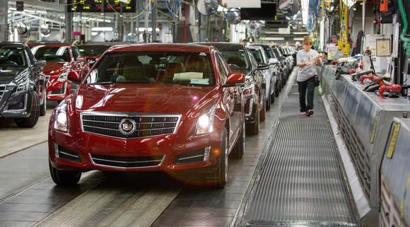 A line of nearly-finished Cadillac ATS sedans on a factory assembly line.