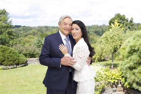 George Soros and Tamiko Bolton are shown as they prepare to attend the reception at Museum of Modern Art (MOMA) in this handout photo released on September 20, 2013. Soros, the 83-year-old billionaire investor, philanthropist and active supporter of liberal political causes, is set to marry health care and education consultant Bolton on Saturday at his estate near New York City. REUTERS/Julie Skarratt Photography/Handout via Reuters