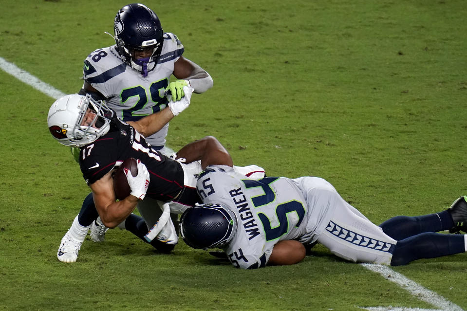 Arizona Cardinals wide receiver Andy Isabella (17) is hit by Seattle Seahawks middle linebacker Bobby Wagner (54) during the second half of an NFL football game, Sunday, Oct. 25, 2020, in Glendale, Ariz. (AP Photo/Ross D. Franklin)