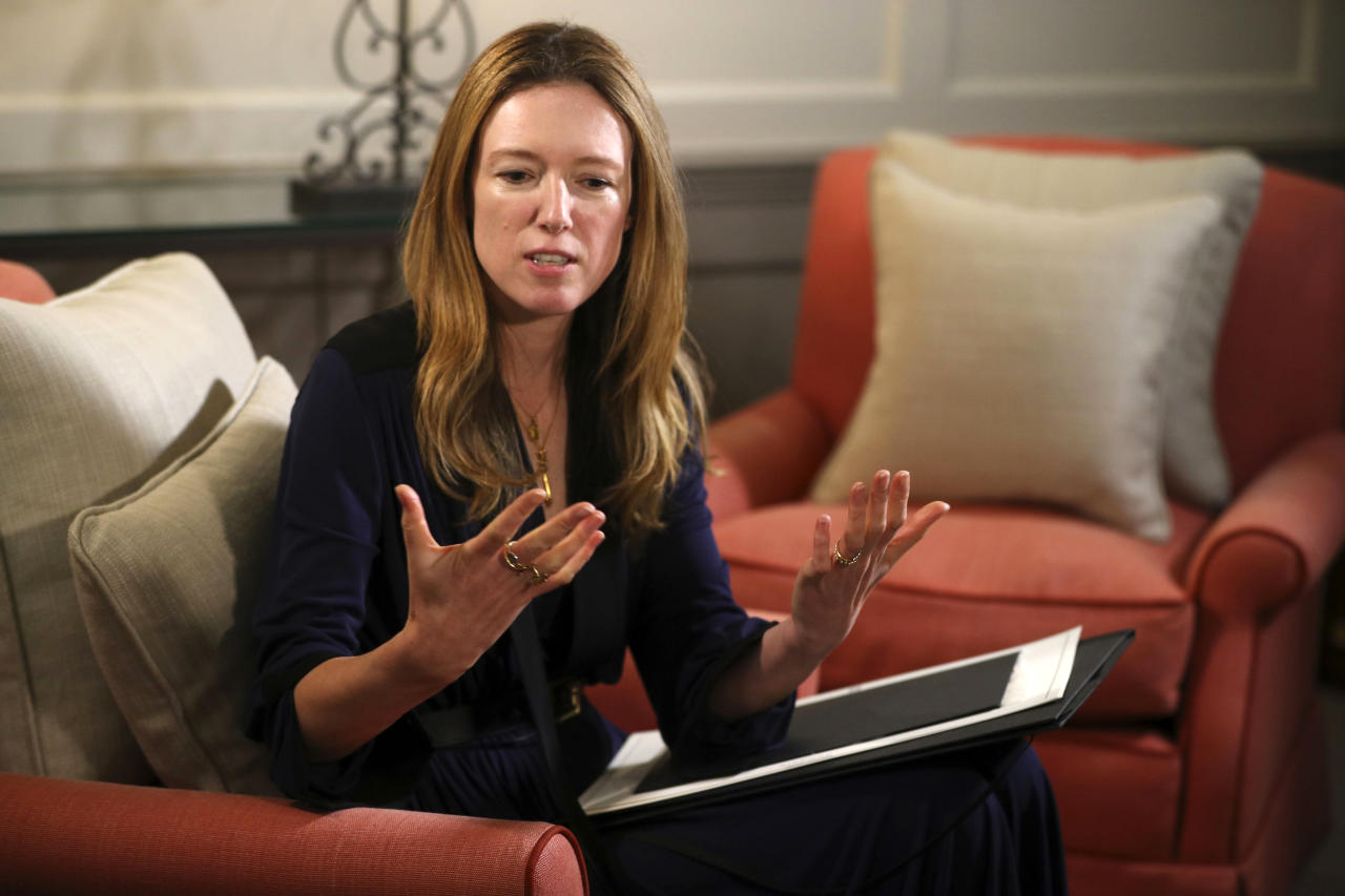 Clare Waight Keller of the French fashion house Givenchy, speaks during an interview at Kensington Palace in London, Sunday May 20, 2018. Clare Waight Keller of Givenchy is the master British designer behind the sleek silk boat-necked gown and long billowing veil worn by Meghan Markle as she walked down the nave of St. George's Chapel for her wedding to Prince Harry (Hannah McKay/Pool via AP)
