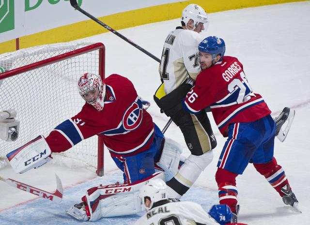 Montreal Canadiens goaltender Carey Price, left, loses his stick as Pittsburgh Penguins center Evgeni Malkin, center, moves in and Canadiens defenseman Josh Gorges defends during second-period NHL hockey game action in Montreal, Saturday, Nov. 23, 2013. (AP Photo/The Canadian Press, Graham Hughes)