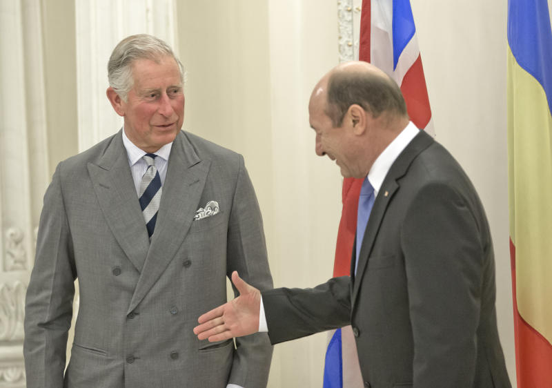 Britain's Prince Charles, left, prepares to shake hands with Romania's President Traian Basescu, right, at the Cotroceni Presidential Palace in Bucharest, Romania. Monday, June 3, 2013.(AP Photo/Vadim Ghirda)