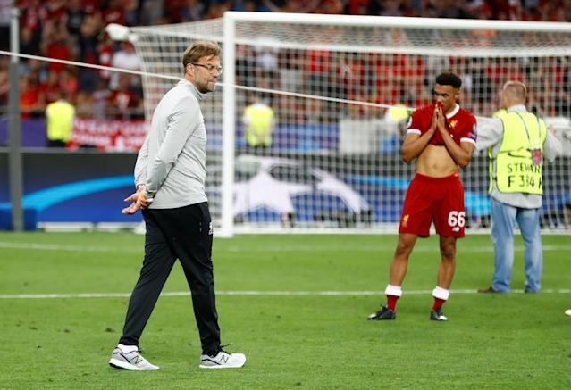 Soccer Football - Champions League Final - Real Madrid v Liverpool - NSC Olympic Stadium, Kiev, Ukraine - May 26, 2018 Liverpool manager Juergen Klopp and Trent Alexander-Arnold react after the match REUTERS/Kai Pfaffenbach