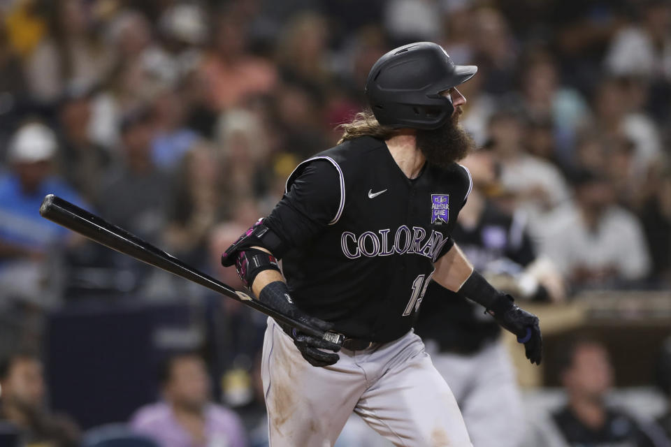 Colorado Rockies' Charlie Blackmon watches his hit against the San Diego Padres during the fourth inning of a baseball game Thursday, July 29, 2021, in San Diego. (AP Photo/Derrick Tuskan)