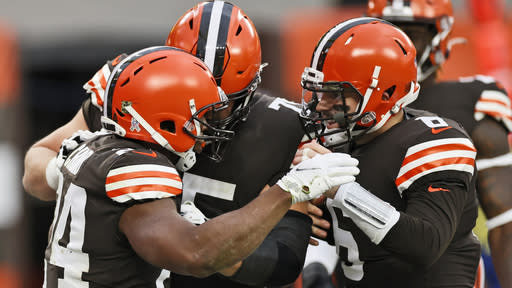 Cleveland Browns quarterback Baker Mayfield, right, congratulates running back Nick Chubb, left, after Chubb rushed for a 9-yard touchdown during the second half of an NFL football game against the Houston Texans, Sunday, Nov. 15, 2020, in Cleveland. (AP Photo/Ron Schwane)