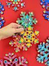 """<p>To make quick work of this project, purchase pre-cut foam snowflakes. Then, set out bowls of colorful rhinestones and some craft glue. </p><p><em>Get the tutorial at <a href=""""https://www.dreamalittlebigger.com/post/simple-but-fabulous-rhinestone-snowflake-ornaments.html"""" rel=""""nofollow noopener"""" target=""""_blank"""" data-ylk=""""slk:Dream a Little Bigger"""" class=""""link rapid-noclick-resp"""">Dream a Little Bigger</a>.</em></p><p><a class=""""link rapid-noclick-resp"""" href=""""https://www.amazon.com/Crafters-Square-Shapes-Inches-Snowflake/dp/B07JZJMCKY?tag=syn-yahoo-20&ascsubtag=%5Bartid%7C10072.g.34443405%5Bsrc%7Cyahoo-us"""" rel=""""nofollow noopener"""" target=""""_blank"""" data-ylk=""""slk:SHOP FOAM SHAPES"""">SHOP FOAM SHAPES</a></p>"""