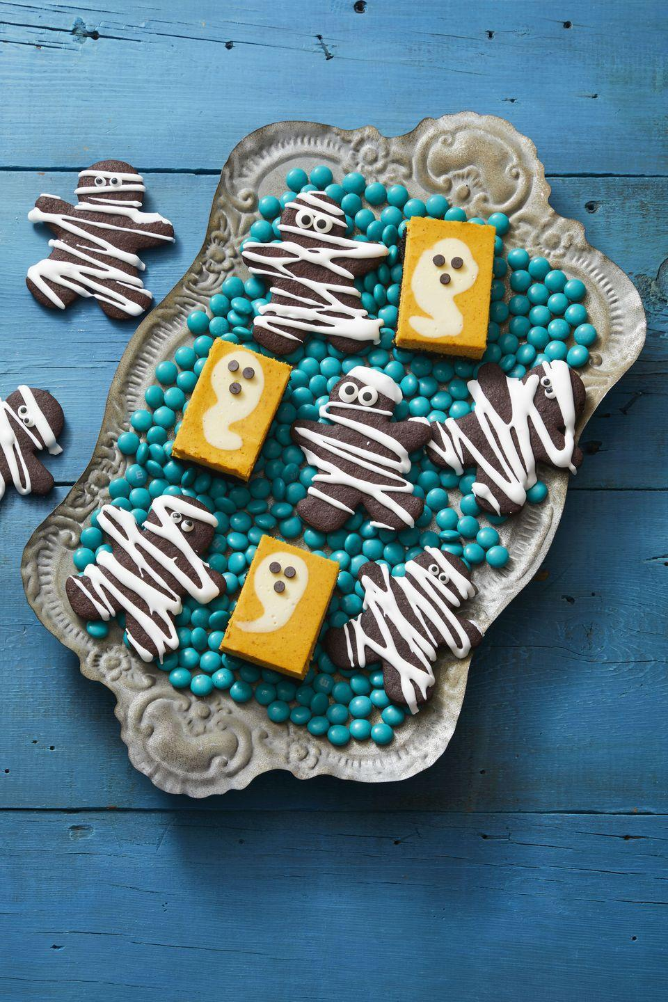 """<p>Your gingerbread man cookie cutter isn't just for Christmas — use it to make these creepy cookies, too.</p><p><a href=""""https://www.womansday.com/food-recipes/a33563511/double-chocolate-mummies-recipe/"""" rel=""""nofollow noopener"""" target=""""_blank"""" data-ylk=""""slk:Get the Double Chocolate Mummies recipe."""" class=""""link rapid-noclick-resp""""><strong><em>Get the Double Chocolate Mummies recipe.</em></strong></a></p>"""