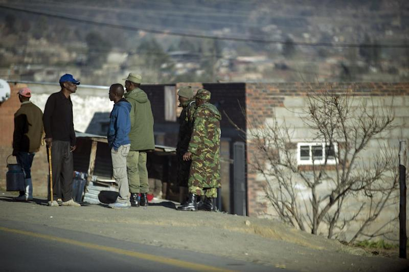 Soldiers stand on September 2, 2014 in a village near Maseru, Lesotho (AFP Photo/Mujahid Safodien)