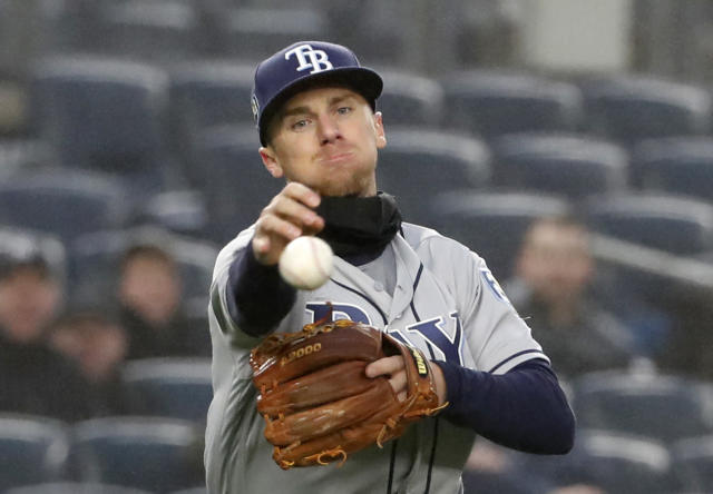 Tampa Bay Rays third baseman Matt Duffy (5) throws to first but commits an error on the throw allowing the go-ahead run to score in the Rays 11-4 loss to the New York Yankees in a baseball game in New York, Tuesday, April 3, 2018. (AP Photo/Kathy Willens)