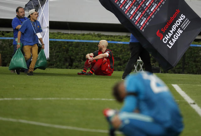 Toronto FC's Michael Bradley and Alex Bono, right, sit dejectedly on the pitch after losing to Chivas in a penalty shootout in the CONCACAF Champions League final. (AP)