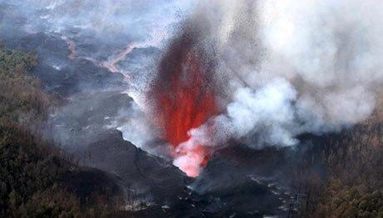 Lava erupts from Nyamulagira volcano in Eastern Democratic Republic of Congo, Tuesday, Jan. 5, 2010. The Nyamulagira volcano, situated some 40 kms North west of the city of Goma, North Kivu capital, erupted Saturday Jan. 2, 2010. (AP Photo/Peterne Inga)
