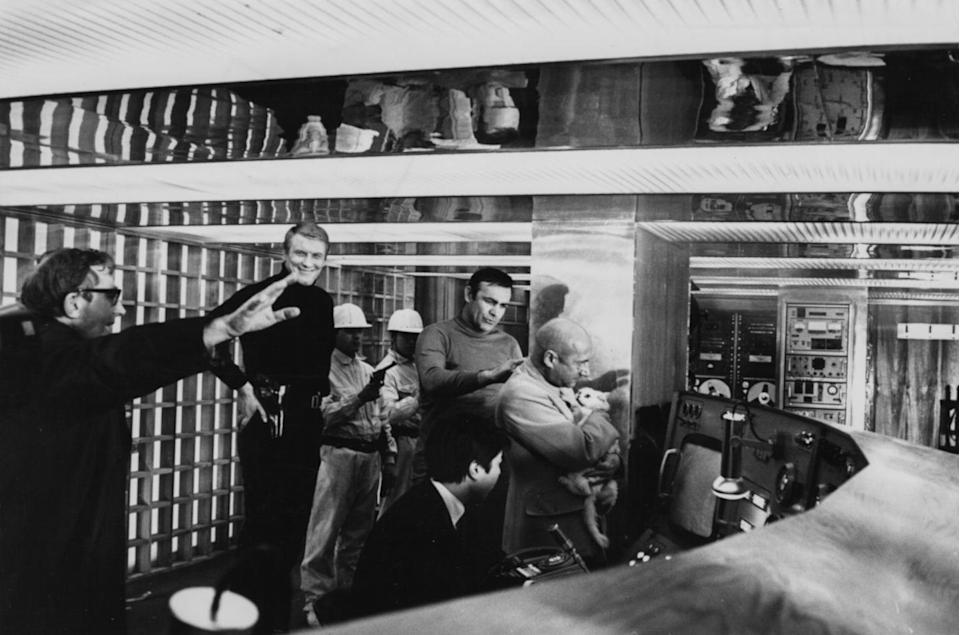 <p>Director Lewis Gilbert talking to actors Ronald Rich, Sean Connery and Donald Pleasance while filming a scene for 'You Only Live Twice', 1967. </p>